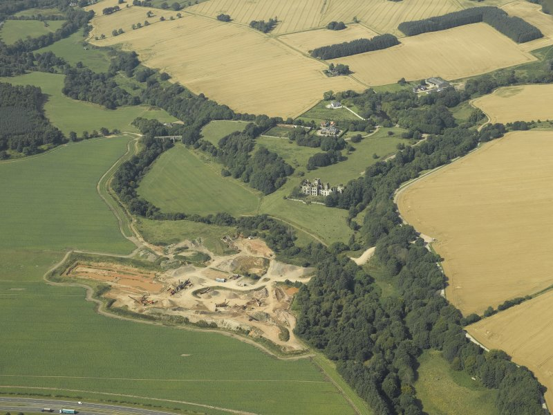 General oblique aerial view centred on the remains of Ury House with the sand and gravel pit adjacent, taken from the SE.