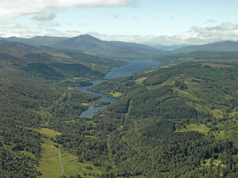 General oblique aerial view of the reservoir with Schiehallion in the distance, taken from the ENE.