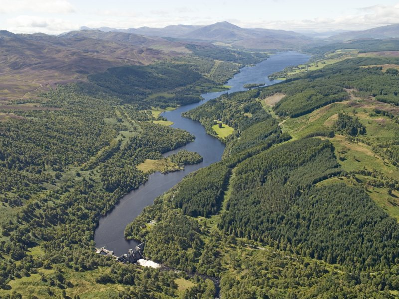 General oblique aerial view of the reservoir with Schiehallion in the distance, taken from the E.