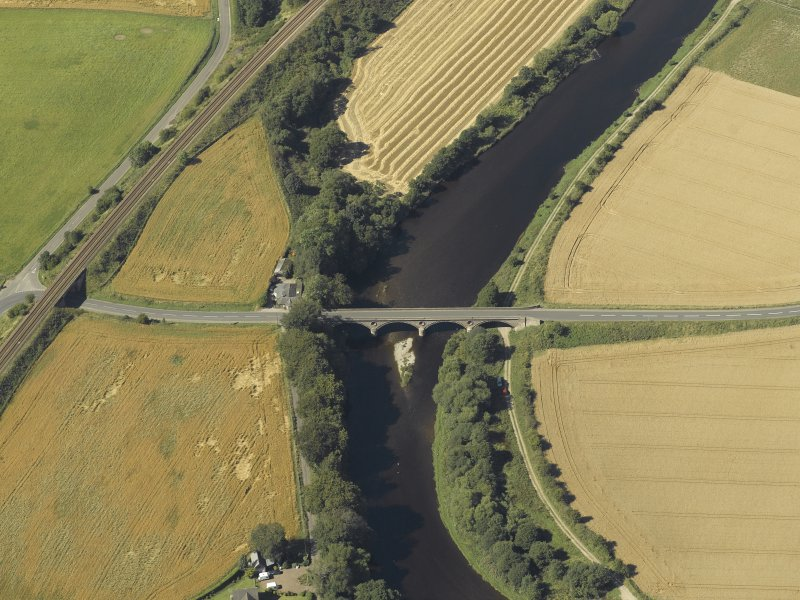 Oblique aerial view centred on the road bridge and the tollhouse, taken from the SE.