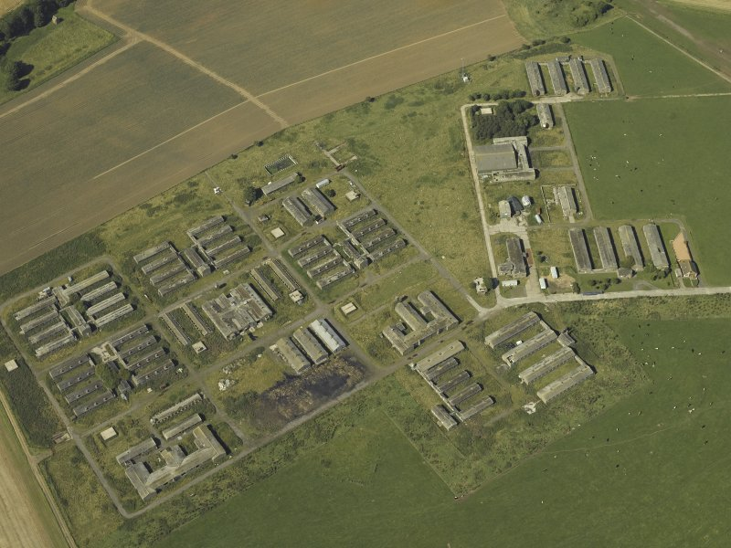 Oblique aerial view centred on the accommodation camp, taken from the S.