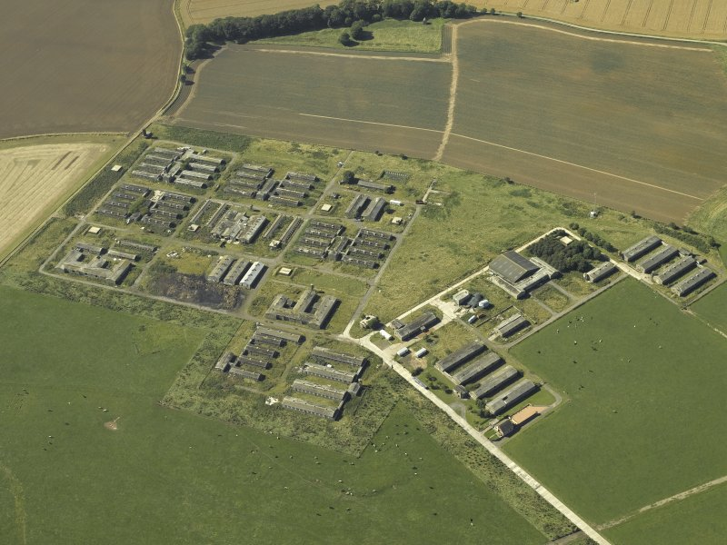 Oblique aerial view centred on the accommodation camp, taken from the SE.