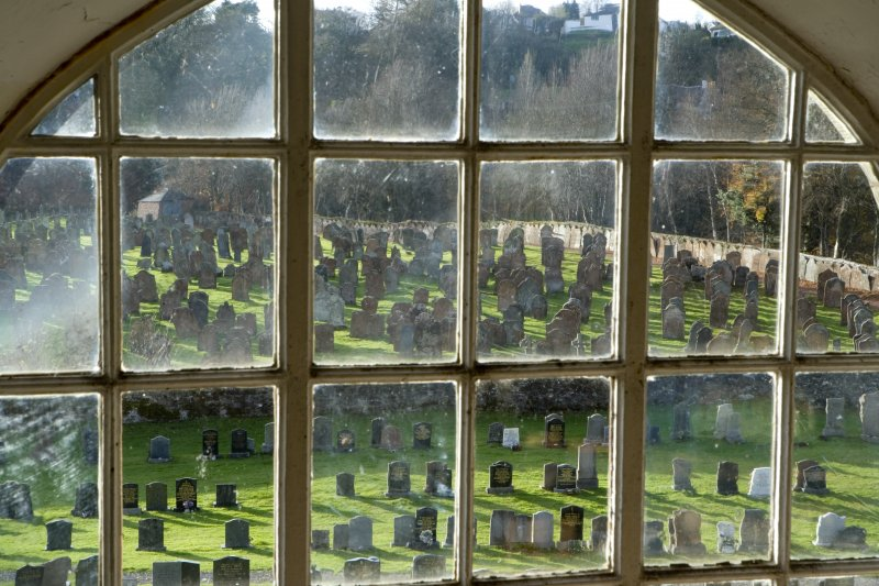 Interior. View through gallery window to graveyard