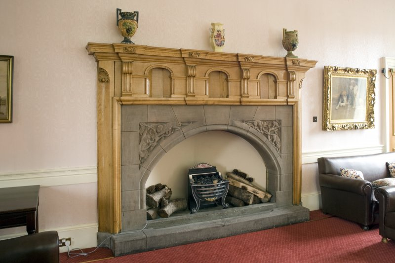 Interior.  Detail of Sir Robert Lorimer designed fireplace in Ante-Room.