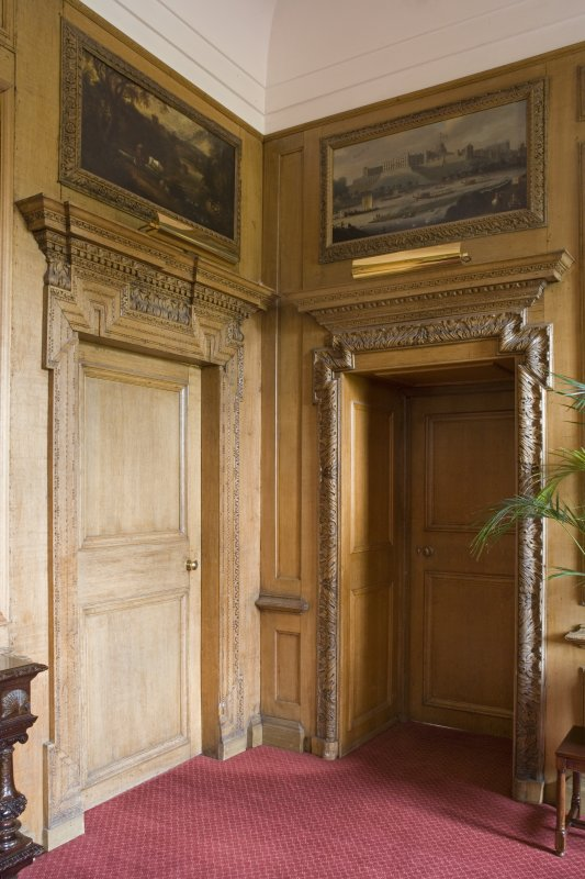 Interior.  General view of carved wooden door frames, entramce to Blue Room and Dining Room.