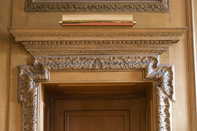 Interior.  Detail of carved wooden door frame entrance to Dining Room from Inner Hall