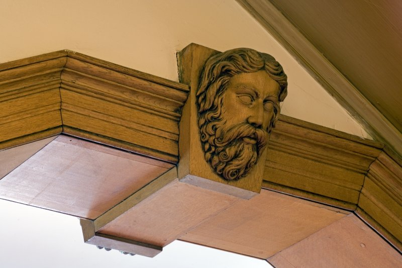 Interior.  Detail of carved wooden head in the Ante-Room.