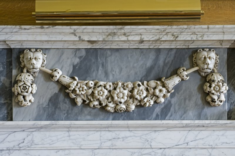 Interior.  Detail of marble carving on white marble fireplace in Blue Room.