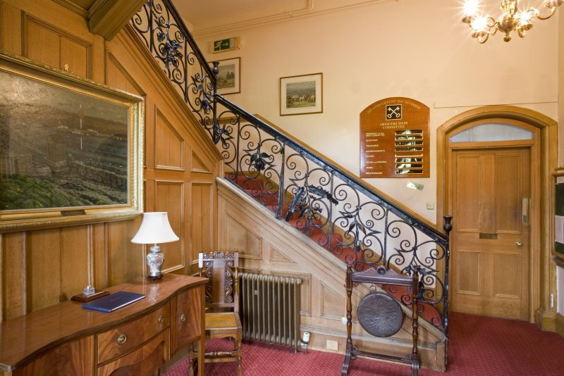 Interior.  General view of entrance hall showing late 17th century wrought-iron staircase.