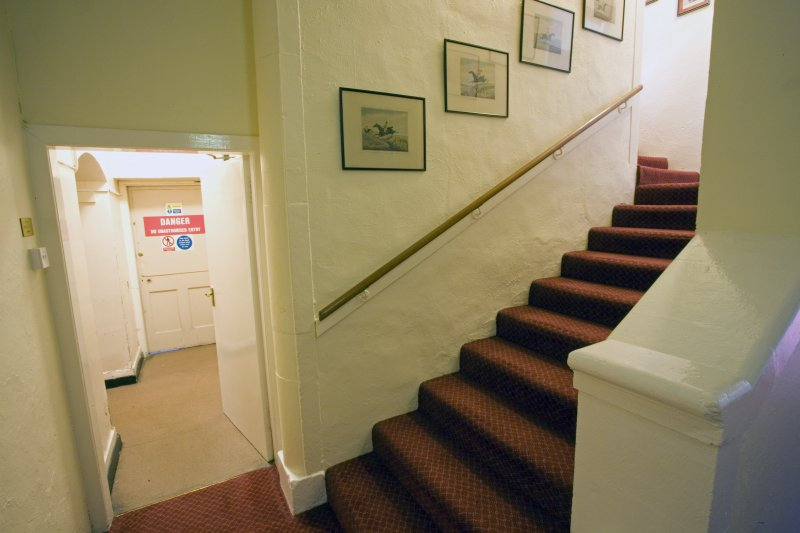 Interior.  Staircase to ground floor from basement.