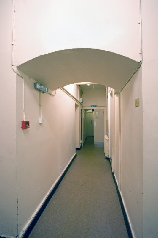 Interior.  Basement corridor, arch through William Burn extension.