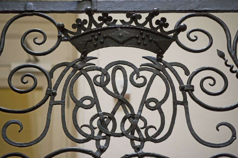 Interior.  Detail of staircase balustrade, monogram of the 2nd Earl of Annandale and his wife, formerly Sophia Fairholm.