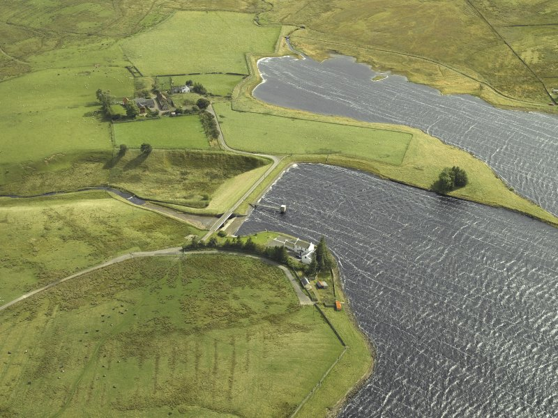 Oblique aerial view centred on the dam and pier, taken from the NW.