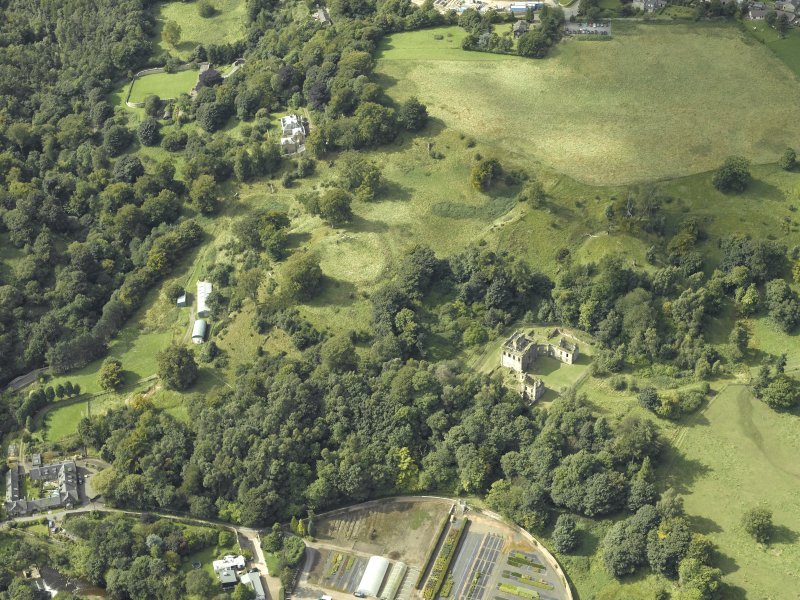 Oblique aerial view centred on the house and walled garden with the earthwork and Blairesk Hall adjacent, taken from the SW.