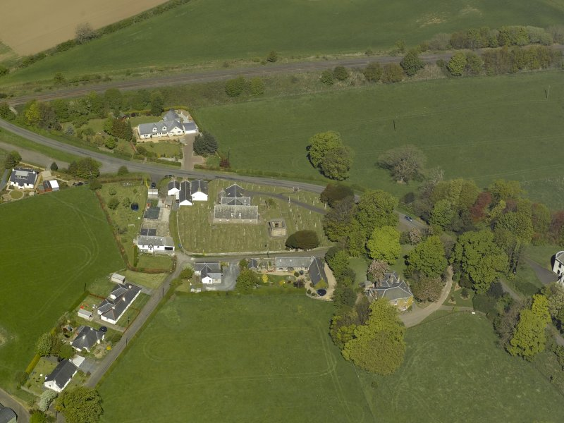 Oblique aerial view centred on the Church with the manse adjacent, taken from the SSE.