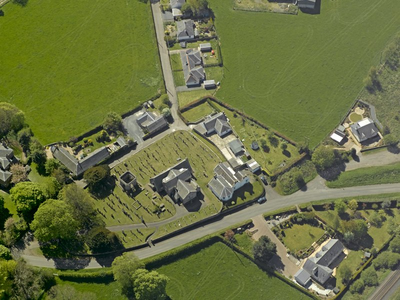 Oblique aerial view centred on the Church with the manse adjacent, taken from the NE.