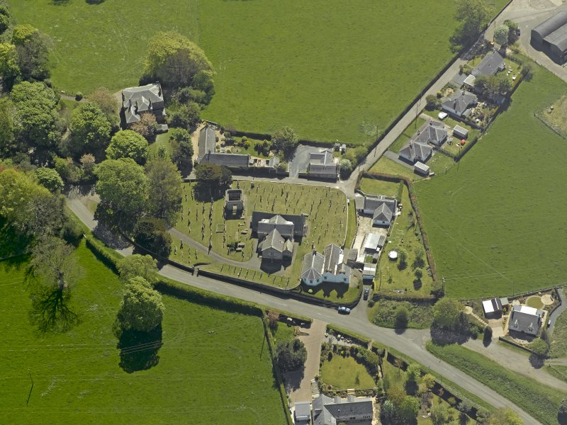 Oblique aerial view centred on the Church with the manse adjacent, taken from the NNW.
