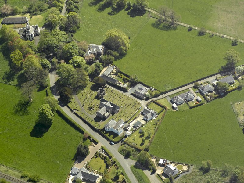 Oblique aerial view centred on the Church with the manse adjacent, taken from the NW.