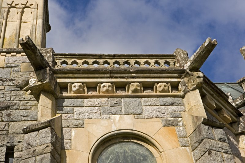 View of carved owl heads on S facade