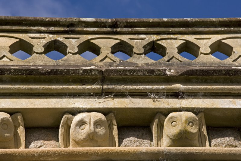 Detail of carved owl heads on south facade, St Conan's Church, Lochawe.
