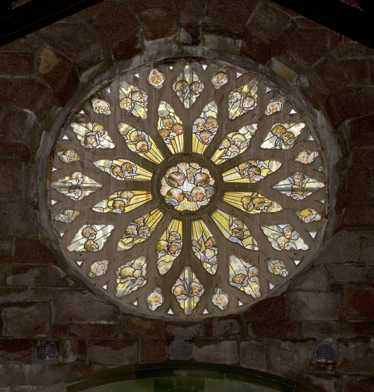 Interior. Nave, view of rose window at W end