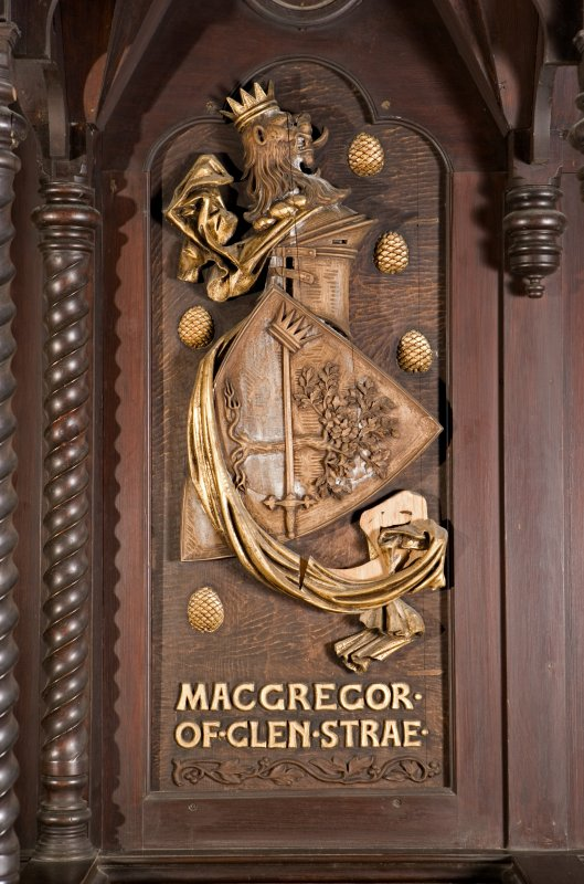 Interior. Choir, detail of coat of arms (Macgregor of Glen Strae ) on back of stall
