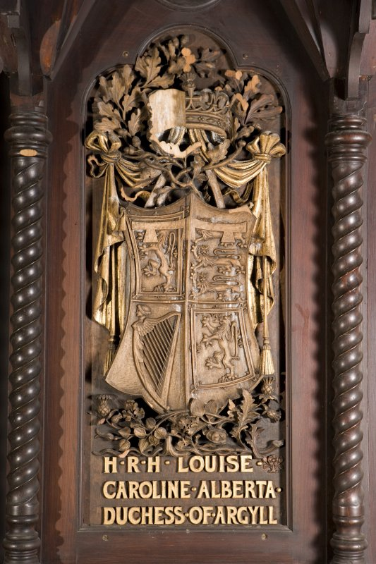 Interior view of St Conan's Church, Lochawe. Choir, detail of coat of arms (H.R.H. Louise Caroline Alberta, Duchess of Argyll) on back of stall