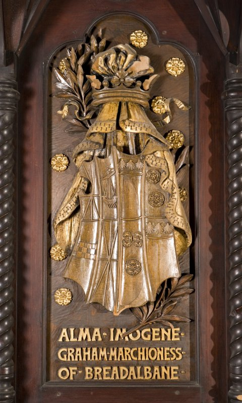 Interior. Choir, detail of coat of arms (Alma Imogene Graham Marchioness of Breadalbane) on back of stall