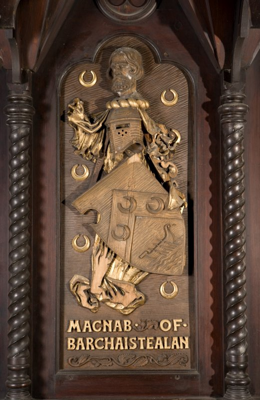 Interior. Choir, detail of coat of arms (Macnab of Barchaistealan) on back of stall