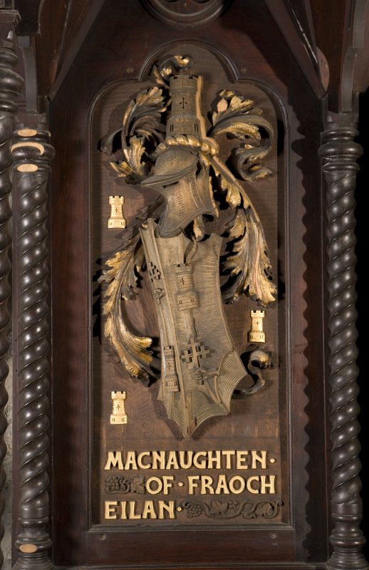 Interior. Choir, detail of coat of arms (Macnaughten of Fraoch Eilan) on back of stall