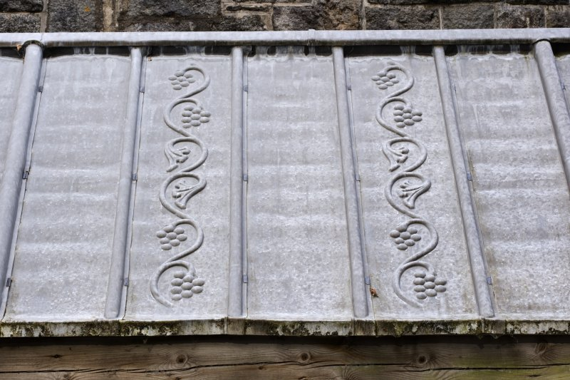 Cloister, detail of embossed decoration on lead roof