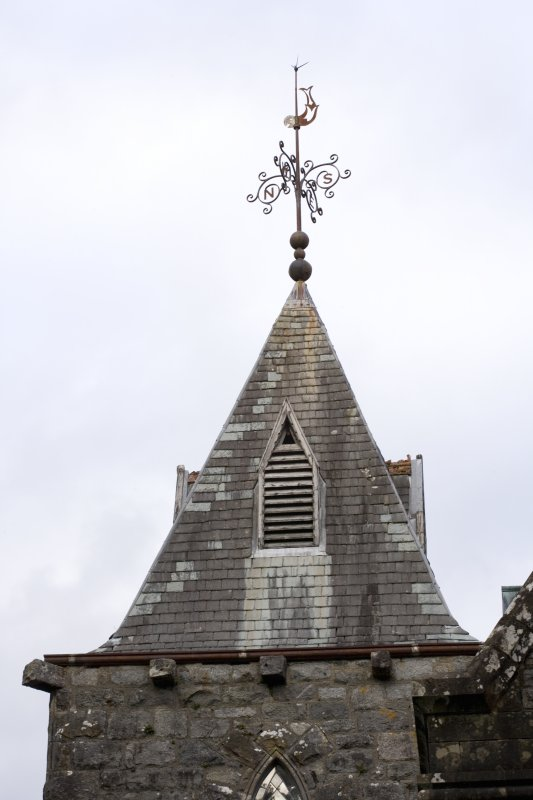 Detail of roof of tower with weather vane