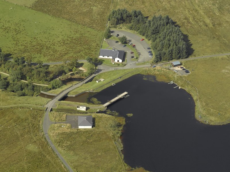 Oblique aerial view centred on the dam and sluice with bridge adjacent, taken from the NE.