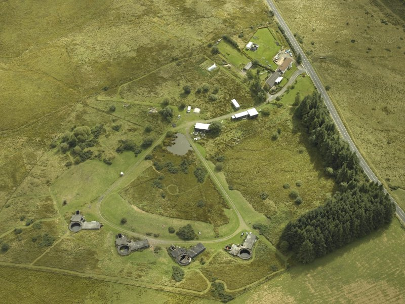 General oblique aerial view centred on postwar anti-aircraft battery, taken from the N.