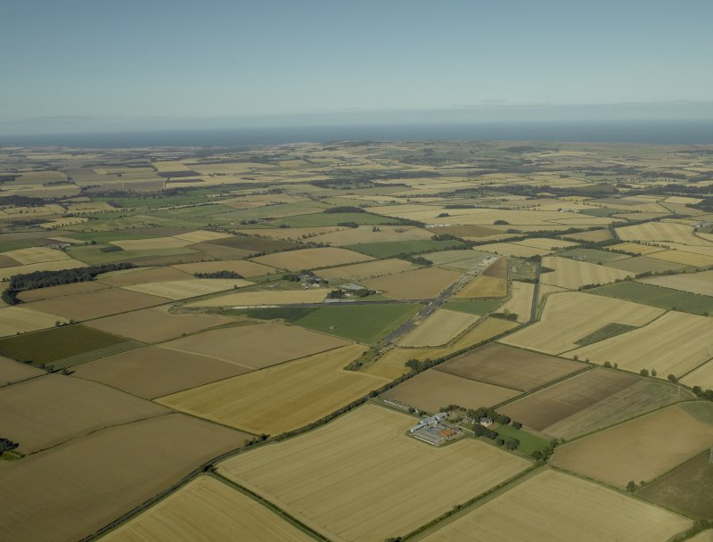 General oblique aerial view of the airfield, taken from the SW.