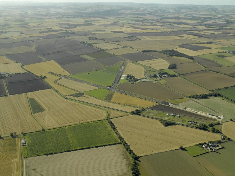 General oblique aerial view of the airfield, taken from the E.