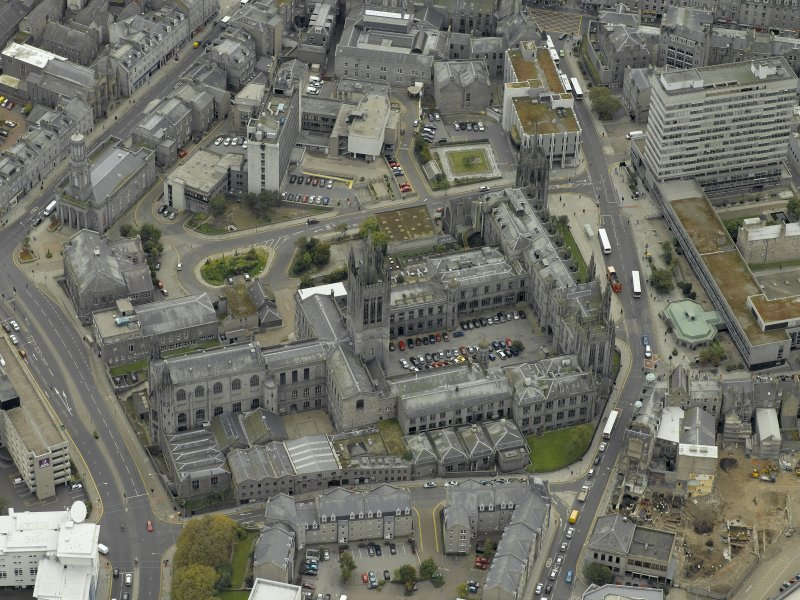 Oblique aerial view of the city centre centred on Marischal College, taken from the NW.
