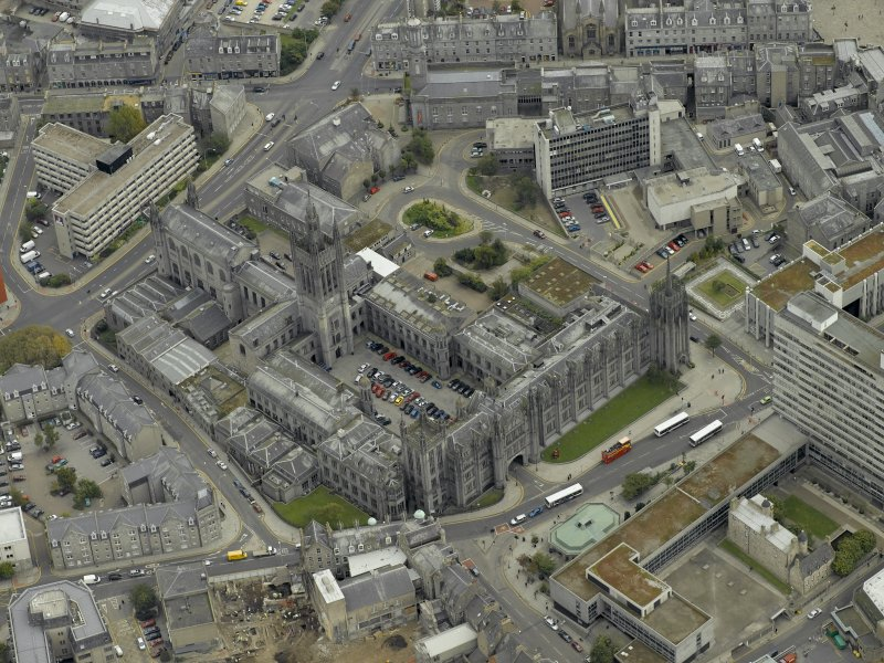 Oblique aerial view of the city centre centred on Marischal College, taken from the W.