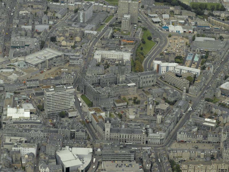 Oblique aerial view of the city centre centred on Marischal College, taken from the SE.