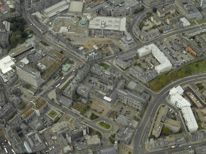 Oblique aerial view of the city centre centred on Marischal College, taken from the ESE.