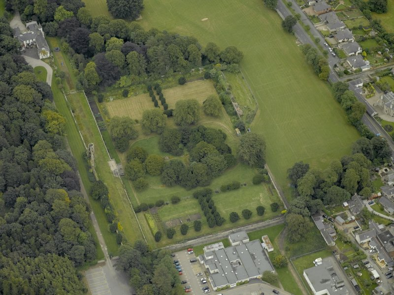Oblique aerial view centred on the remains of Ellon Castle and walled garden, taken from the WNW.
