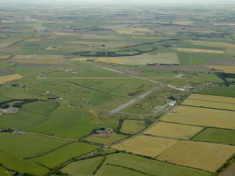 General oblique aerial view centred on the airfield, taken from the NE.