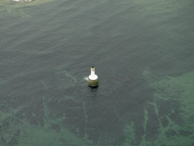 Oblique aerial view centred on the lighthouse, taken from the WNW.