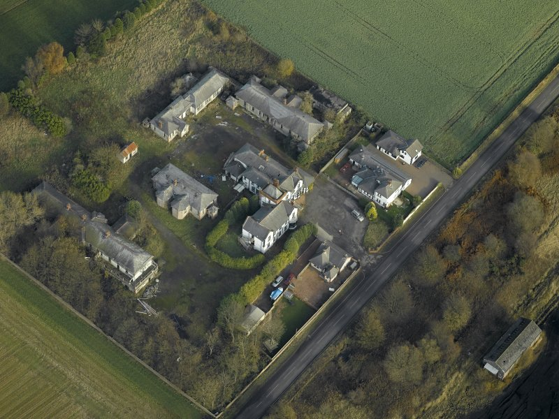Oblique aerial view centred on the house and hospital buildings, taken from the SW.