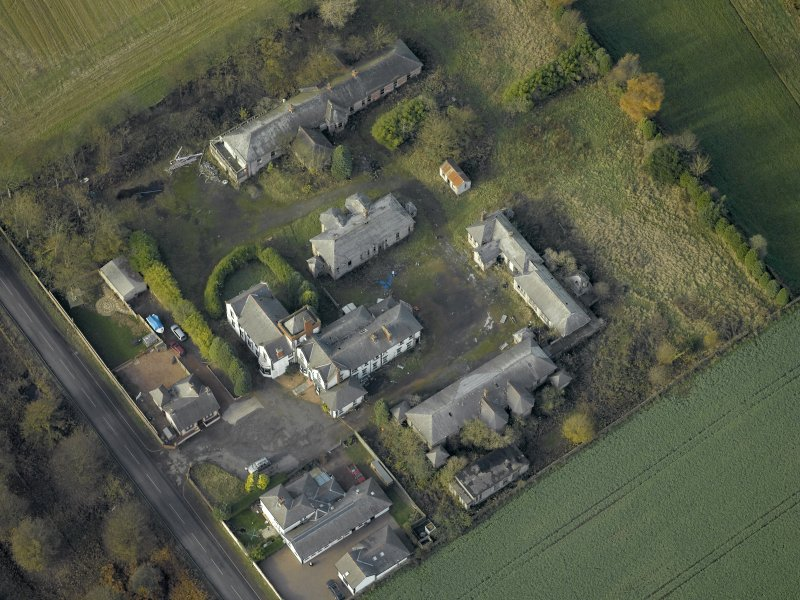 Oblique aerial view centred on the house and hospital buildings, taken from the SE.