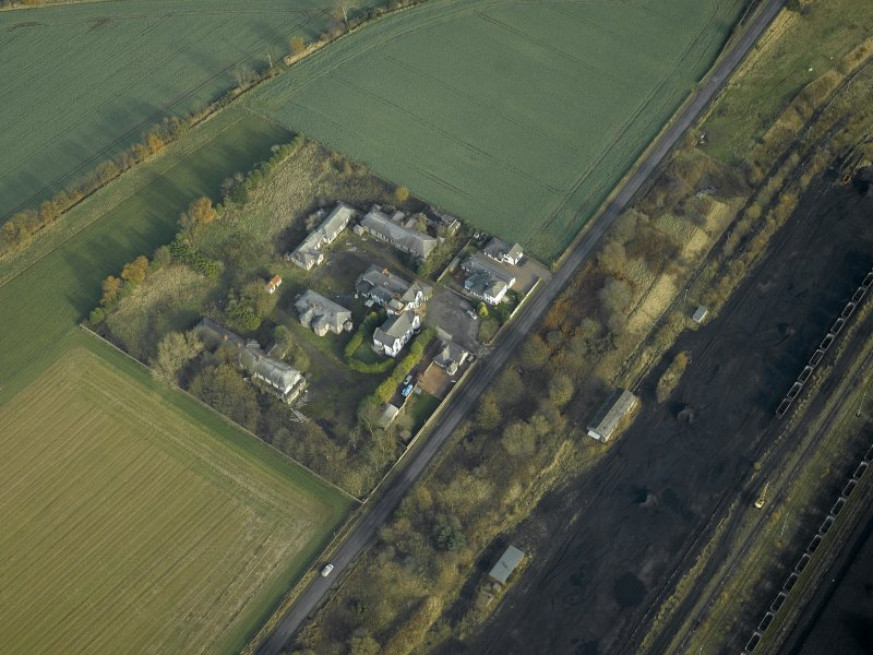 General oblique aerial view centred on the house and hospital buildings, taken from the SW.