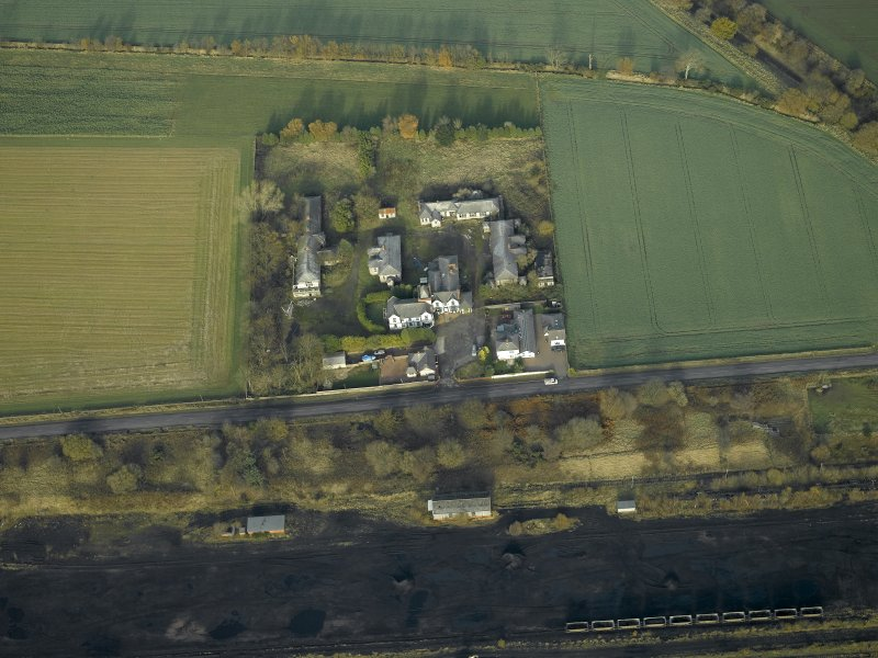 General oblique aerial view centred on the house and hospital buildings, taken from the S.