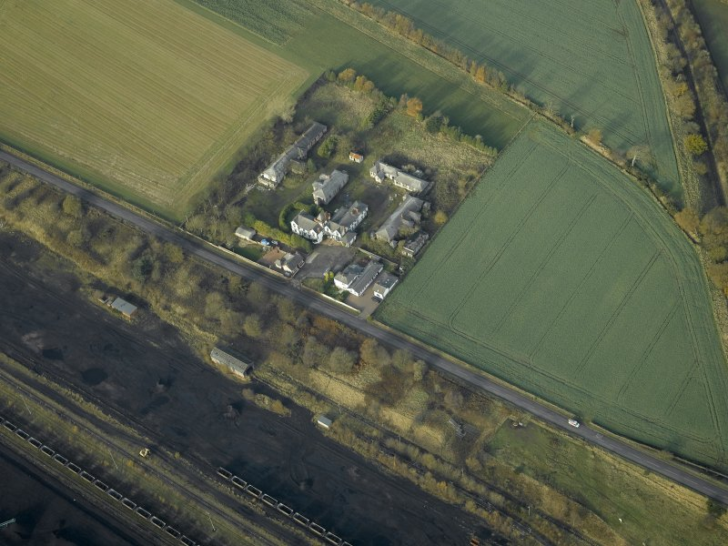 General oblique aerial view centred on the house and hospital buildings, taken from the SE.