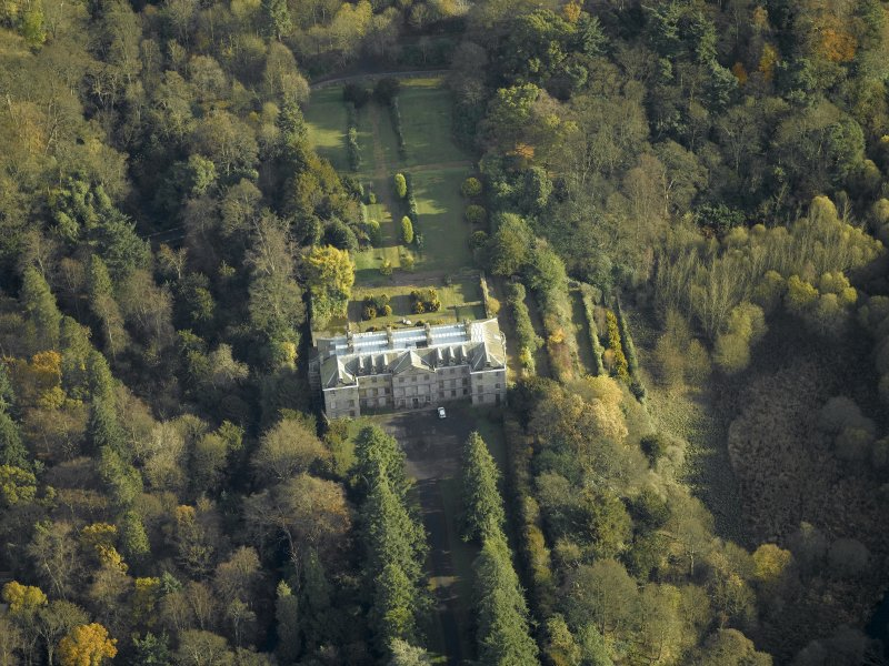 Oblique aerial view centred on the house, taken from the WNW.
