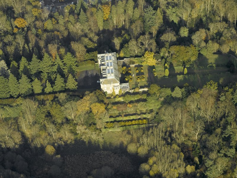 Oblique aerial view centred on the house, taken from the SSW.